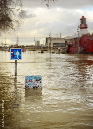 Road signs on flooded by Seine river street