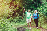Elderly couple admiring nature and walking - 190100623