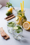 detox cocktails with cucumber and lemon on a light background, healthy lifestyle, fitness drinks