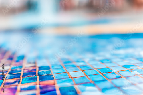 Abstract bokeh background of colorful turquoise blue tiles in water fountain