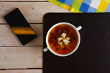 Top view of table with lunch. Plate of bean soup with meat. - 190141647