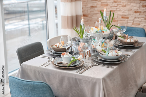 Beautiful Easter table setting with decorations - 190156001