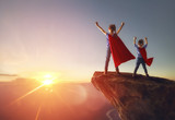 children are playing superhero - 190172210