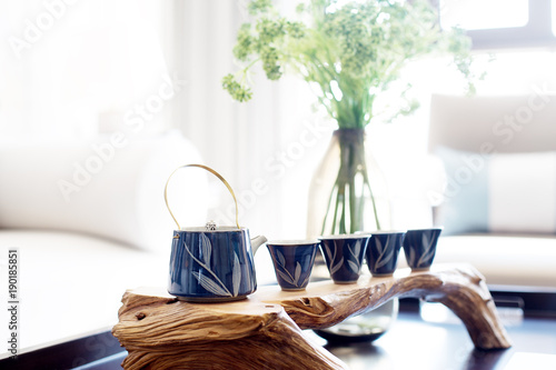 elegant tea pot and cup on table