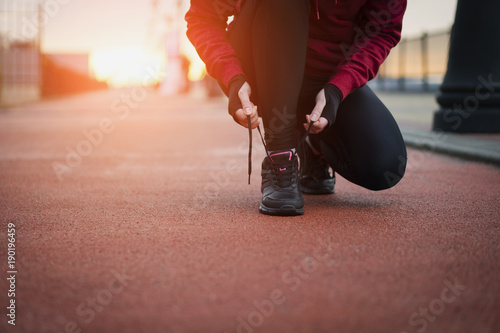 The Runner woman ties the shoelaces before running. Healthy lifestyle.