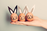 Three little Easter bunnies made from an egg - 190206635