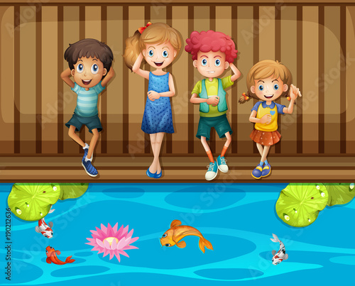 Four children having fun by the fish pond