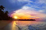 Colorful sunset on tropical beach.