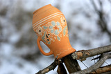 Traditional Ukrainian clay jug on a wooden fence in village. - 190235053