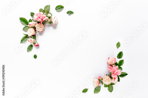 Border frame with pink rose flower buds branches isolated on white background. Flat lay, top view. Floral background. Floral frame. Frame of flowers. - 190240486