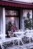 Seats at an outdoor café in Venice, Italy.