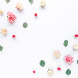Border frame with pink rose flower buds and eucalyptus branches isolated on white background. Flat lay, top view. Floral background. Floral frame. Frame of flowers.