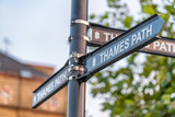 Thames path signs in Canary Wharf, London - 190244859