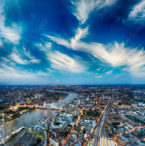 Fotobehang London Tower Bridge and city skyline along river Thames at night, aerial view - London - UK