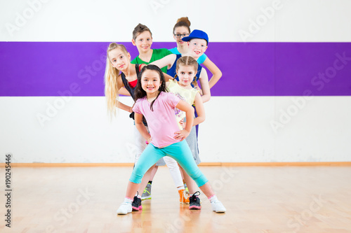 Children in zumba class dancing modern group choreography  - 190245446