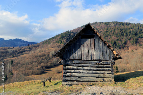 Fotobehang Lente wooden house in mountains