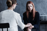 Therapist looking after her patient - 190255010