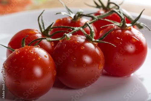 Fotobehang Kersen Fresh raw cherry tomatoes on plate