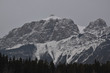 Snow Covered Rocky Mountains with Hazy Grey Sky