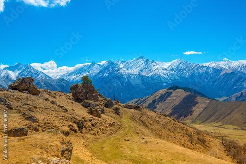 Foto op Aluminium Blauw beautiful spring day landscape with snow covered peaks of Caucasus mountains, Russia, Republic Ingushetia, close up
