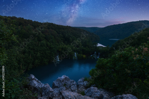 Plitvice Lakes National park, amazing night landscape from popular viewpoint with starry sky and Milky Way. Panoramic view of waterfalls and lakes surrounded by forests, Croatia © larauhryn