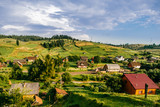 Countryside rural nature landscape in summer sunny day. Discover Ukraine. Village in Carpathians mountains. Beautiful scenic view at green hills and rustic terrain. Farmer houses in forest territory. - 190283698