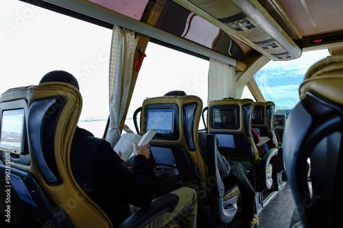 Fototapeta Interior of a bus with many seats