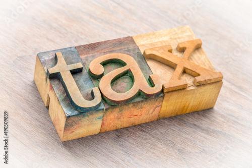 tax word in letterpress wood type