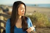 Young Asian woman looking far away - 190317287
