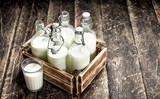 Bottles with fresh milk in a box. - 190340049