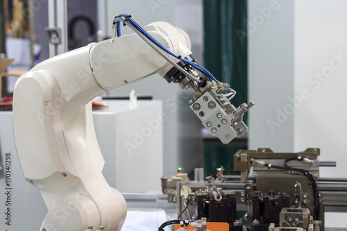 Factory 4.0 concept: View of gripper unit on handerling robot arm of automation machine.