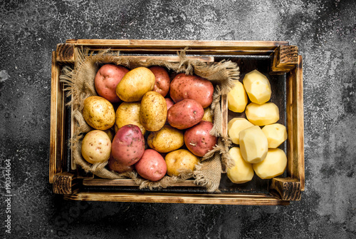Fresh potatoes in a box.