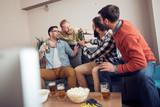 Friends watching football game - 190345439