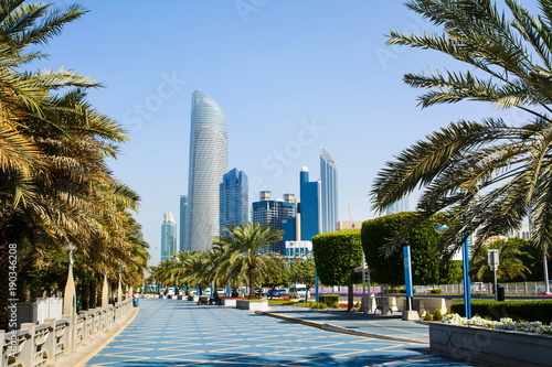 Fotobehang Abu Dhabi Abu Dhabi Corniche walking area with landmark view of modern bui
