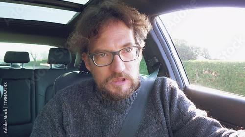 Unhappy man starting car driving