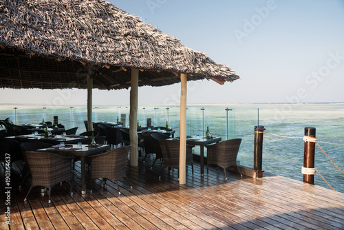Fotobehang Zanzibar Wooden terrace with sea view