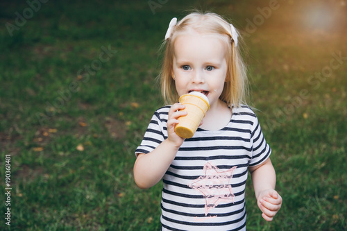 Little girl eating delicious ice cream