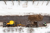 above view of workers and tractor digging road