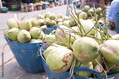 Fotobehang Bangkok Fresh young coconut on plastic container for sell at fruit market, Mahanak, Bangkok, Thailand