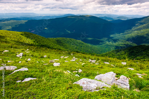 Keuken foto achterwand Nachtblauw Carpathian alps with huge boulders on hillsides. beautiful summer landscape on overcast day. Location Polonina Runa, Ukraine