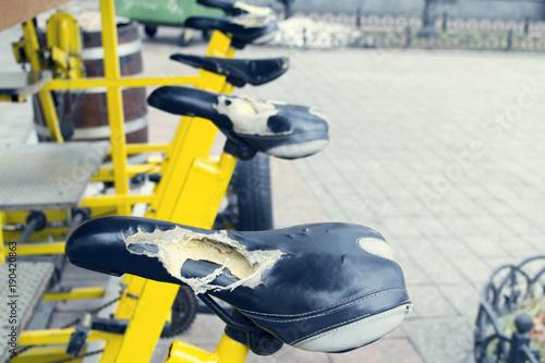 Fotobehang Fiets An old broken bicycle seat