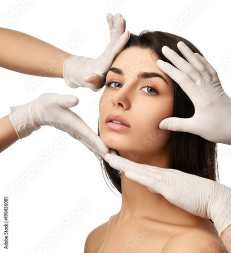 Beautiful young woman face plastic surgery and doctor hands in medical gloves
