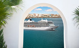 View from under the white stone arch of luxury cruise ship sailing from port  - 190439472