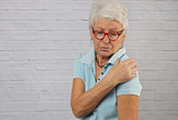 Senior Woman suffering from shoulder Pain . Chiropractic concept - 190442630