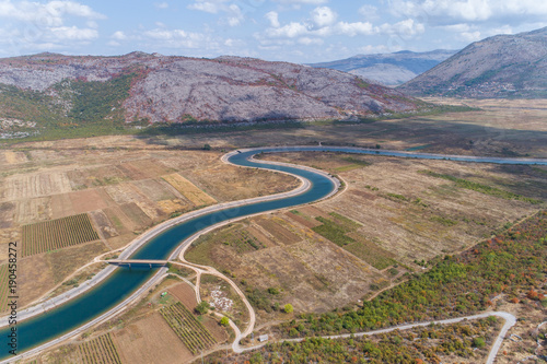 Fotobehang Bergrivier Aerial view to the valley and the Trebishnica river in the Bosnia and Hercegovina mountains.