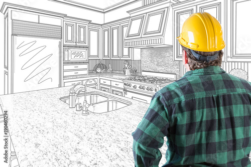 Male Contractor with Hard Hat and Tool Belt Looking At Custom Kitchen Drawing Photo Combination On White. - 190460294