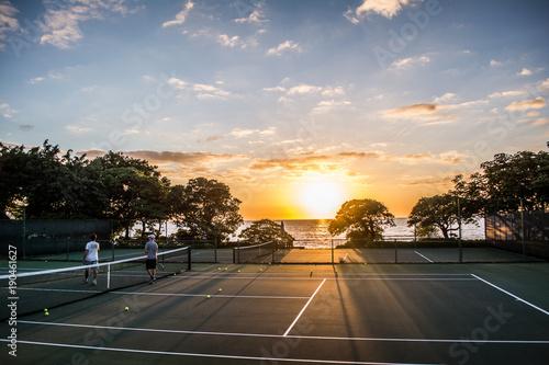 Fototapeta tennis court at sunset