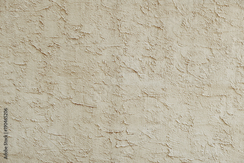 Poster Betonbehang Old beige stone wall background texture