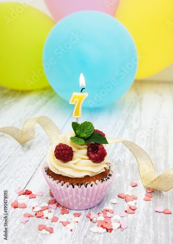 Poster Cupcake with a numeral seven candle