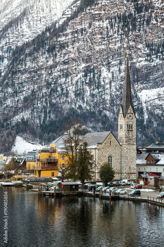 Foto Murales Lake view at the tower and houses of Hallstatt, famous picturesque village in Austria. Vertical